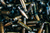 istock pile of used rifle cartridges 7.62 mm caliber, many empty bullet shells, assault rifle bullet shell, military background, top view 1132198644