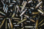 istock pile of used rifle cartridges 7.62 mm caliber, many empty bullet shells, assault rifle bullet shell, military background, top view 1134789929