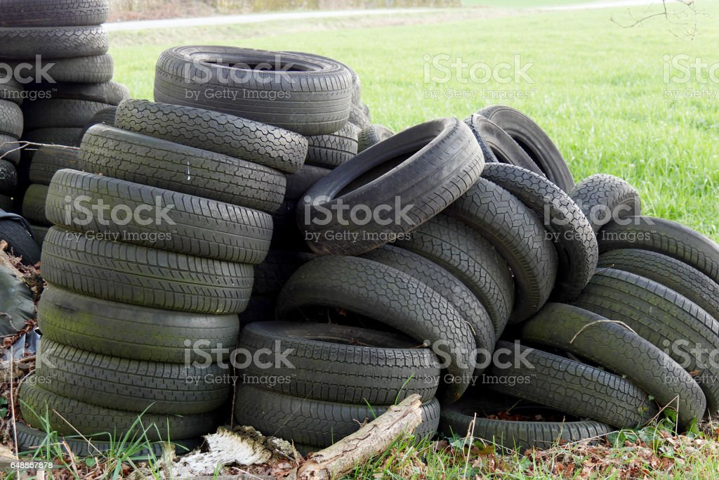 Pile of used tires in  countryside stock photo