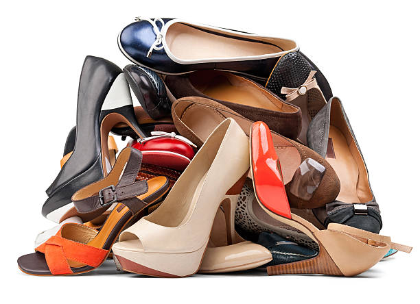 Pile of various female shoes, with clipping path stock photo