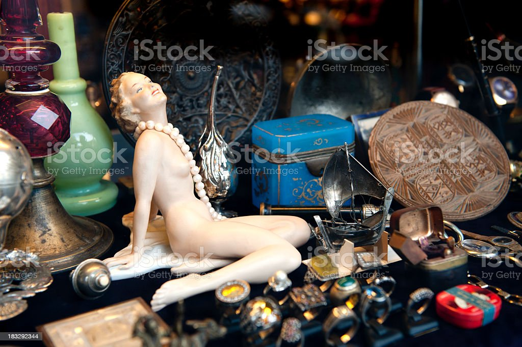 A pile of various items at a flea market stock photo