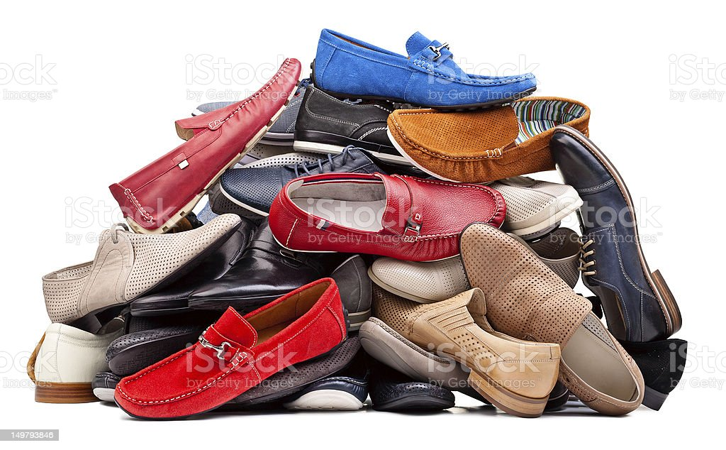 Pile of various men shoes, with clipping path stock photo