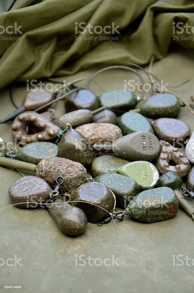 Pile of Various Shaped Carp Fishing Lead Weights stock photo