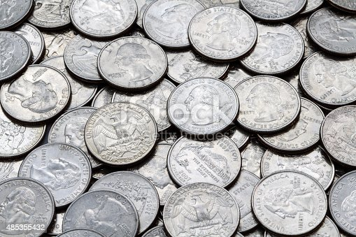 A close up shot of a pile of various used modern clad (non-silver, Cupronickel) USA Washington Quarters.