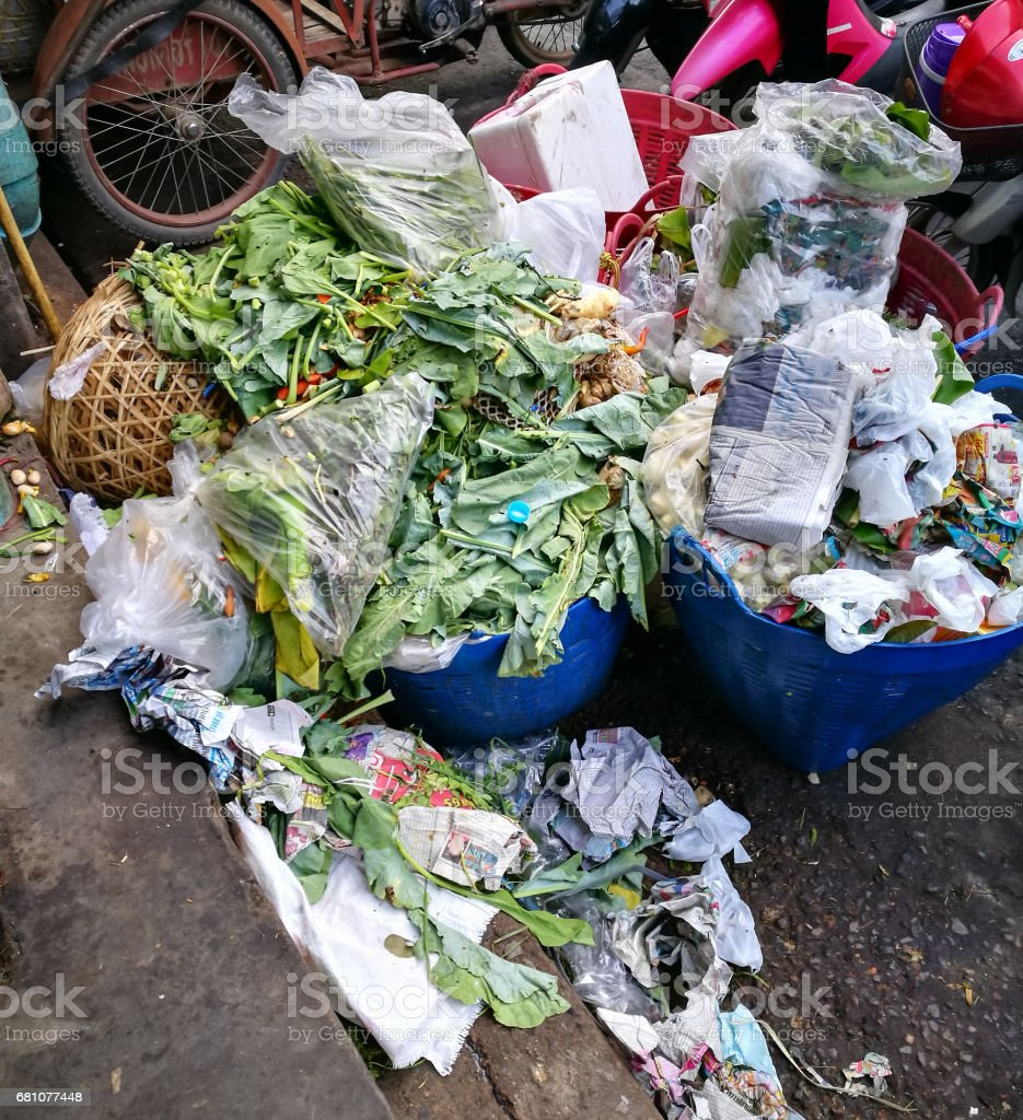 Pile of vegetable throw away as garbage at fresh-food market royalty-free stock photo