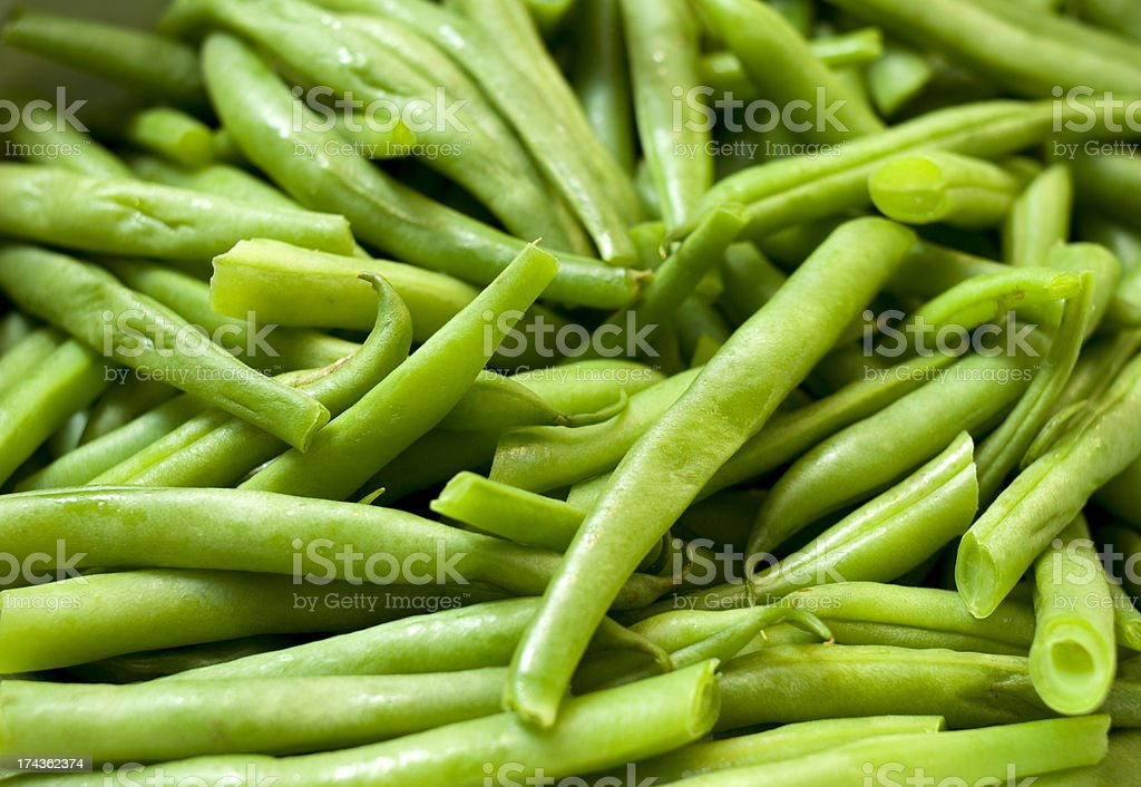 A pile of vibrant green beans background stock photo