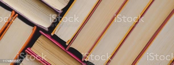 Pile of vintage paper orange books in hard cover fall reading list picture id1174800337?b=1&k=6&m=1174800337&s=612x612&h=u8iprywin4jfytkbm ierf54fms3nyjdnkmqcjet4km=
