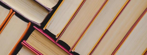 Pile of vintage paper orange books in hard cover fall reading list picture id1174800337?b=1&k=6&m=1174800337&s=612x612&w=0&h=k1bps7crmtk9swlzmx7ejaahsmgq1fk d86pq1xfeqc=