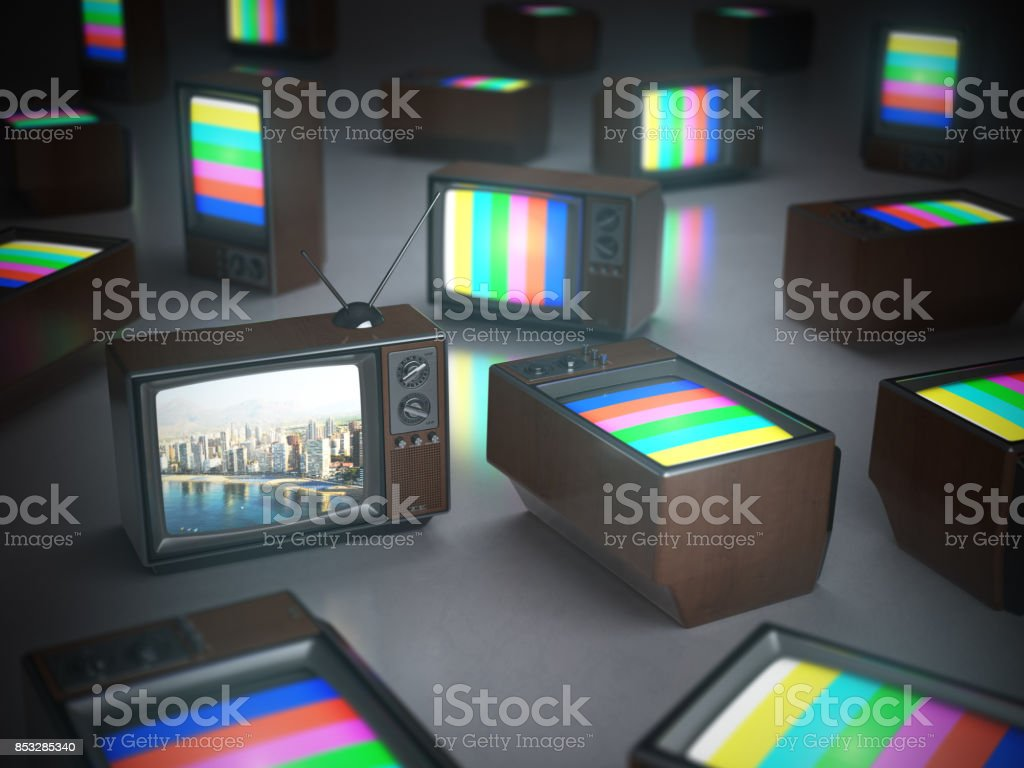 Pile of vintage TV with one in standby. TV channels concept stock photo