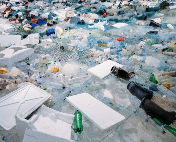 Pile of waste plastic bottles and other trash - human impact on environmental damage concept stock photo