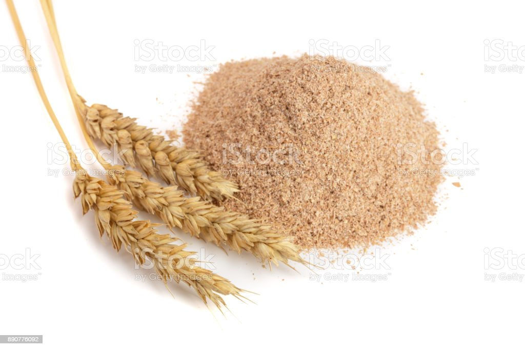 Pile of wheat bran with ears isolated on white background stock photo
