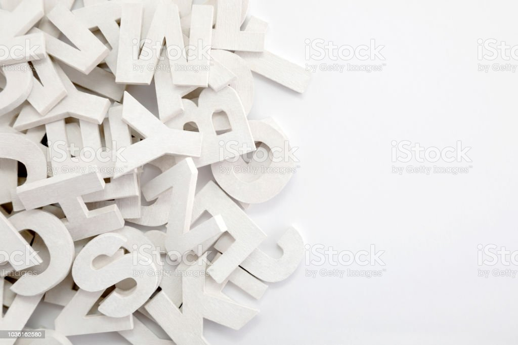 Pile of white painted wooden letters. Typography background composition. - Foto stock royalty-free di A forma di blocco