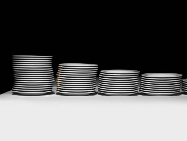pile of white plates on a black background - commercial dishwasher stock photos and pictures