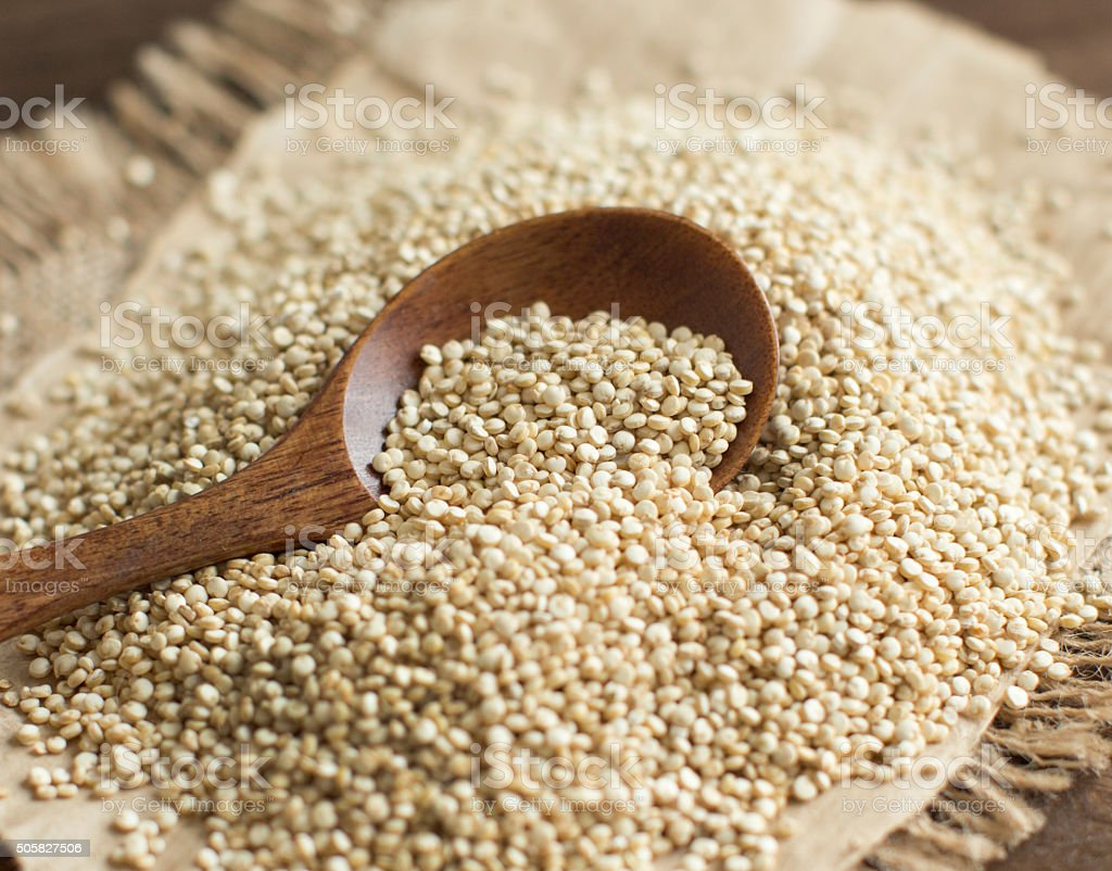Pile of White Quinoa with a spoon stock photo