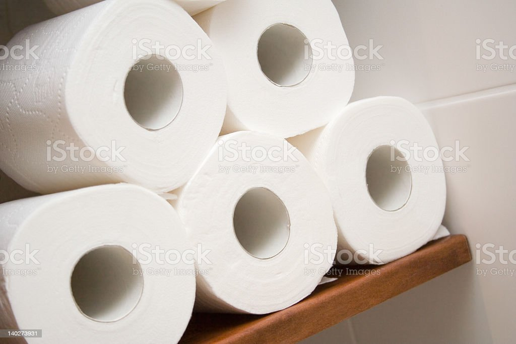 Pile of white soft toilet paper rolls stock photo