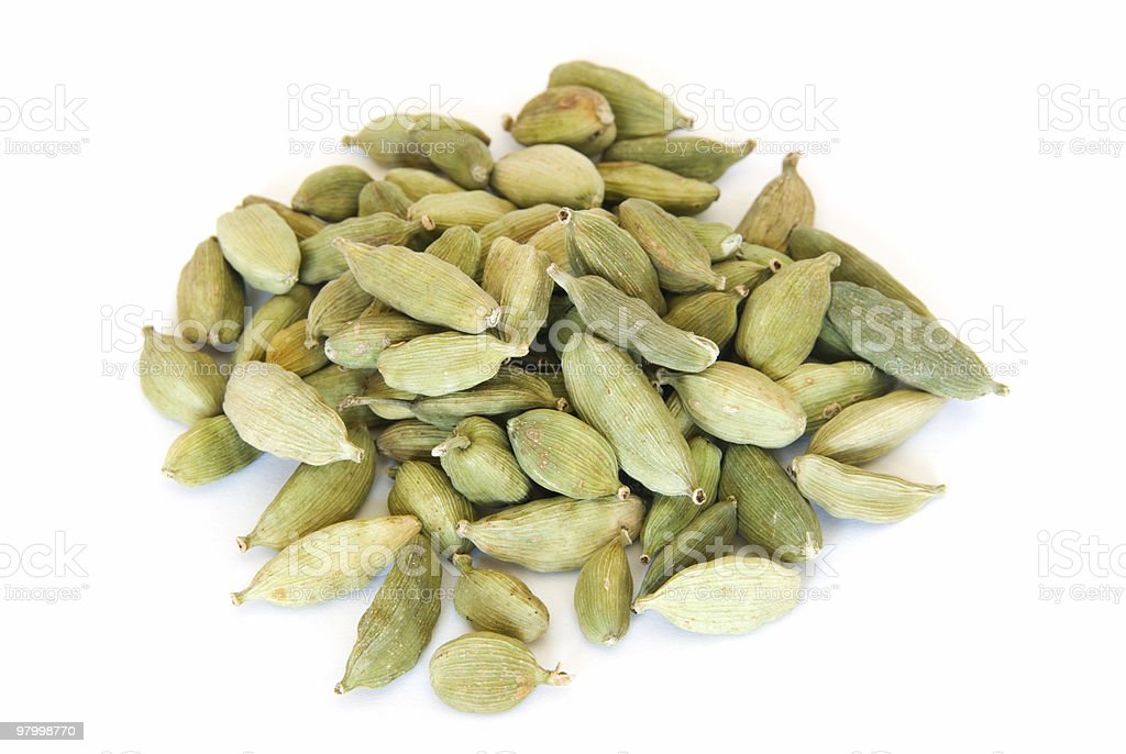 Pile of whole cardamom on white royalty free stockfoto