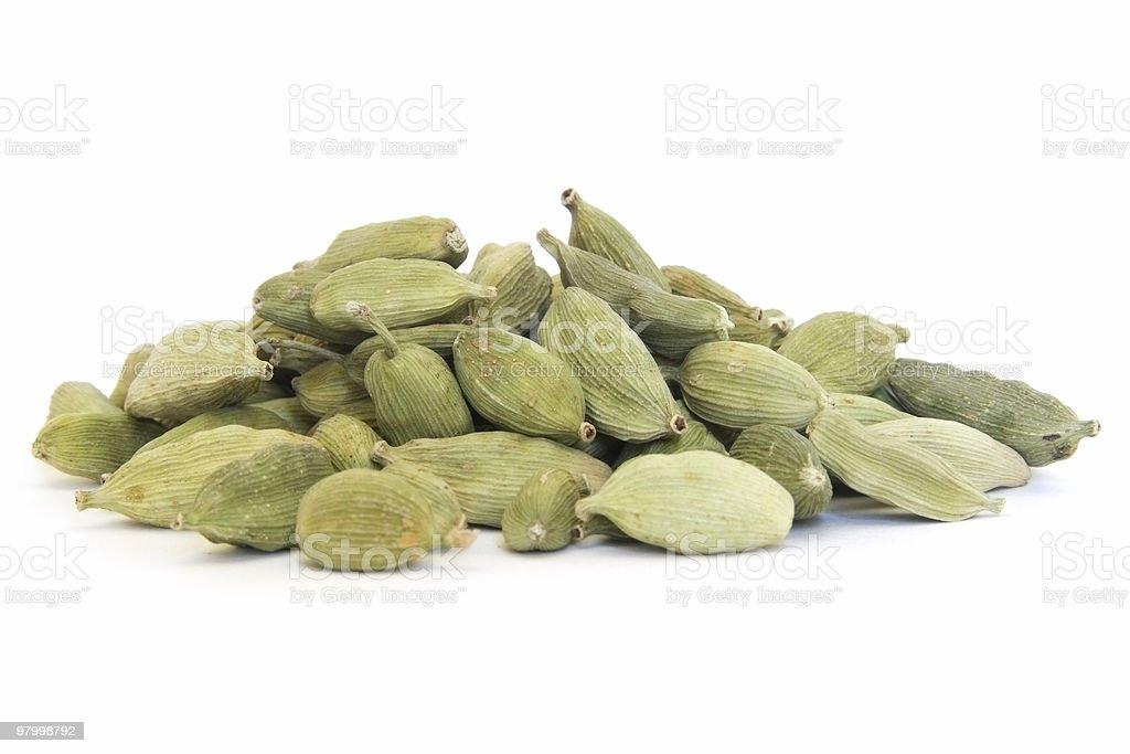 Pile of whole cardamom on white stock photo