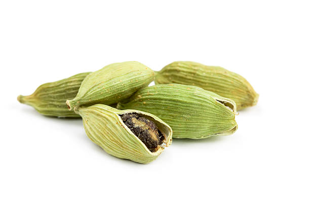 Pile of whole cardamom Pile of whole cardamom isolated on white background cardamom stock pictures, royalty-free photos & images