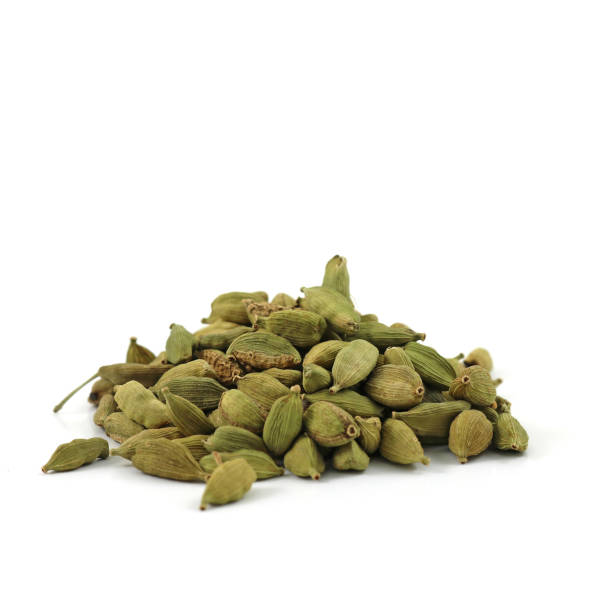 Pile of whole green cardamom pods stock photo