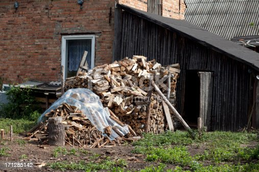pile of wood near the house