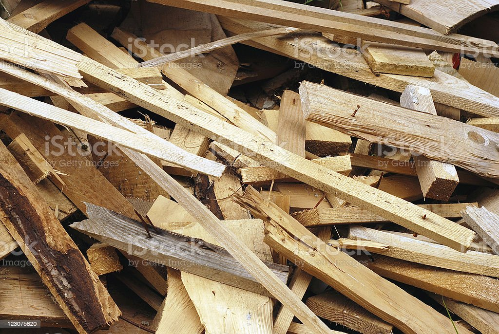 Pile of wood scraps some with the nails in them stock photo