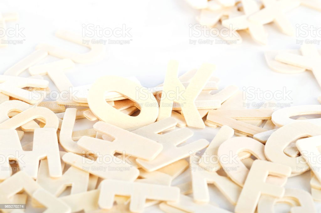 Pile of wooden block letters isolated zbiór zdjęć royalty-free