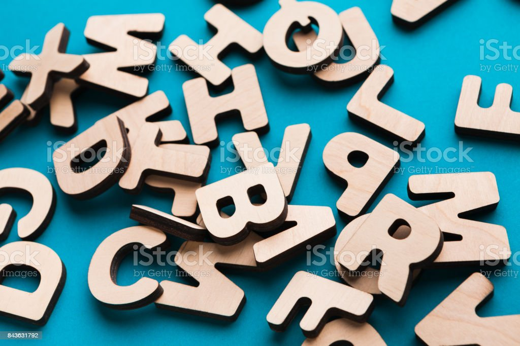 Pile of wooden english letters background stock photo