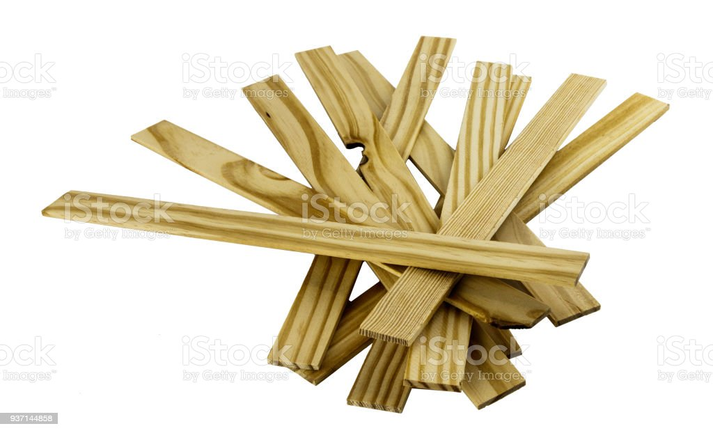 Pile of wooden paint stir sticks on a white background stock photo
