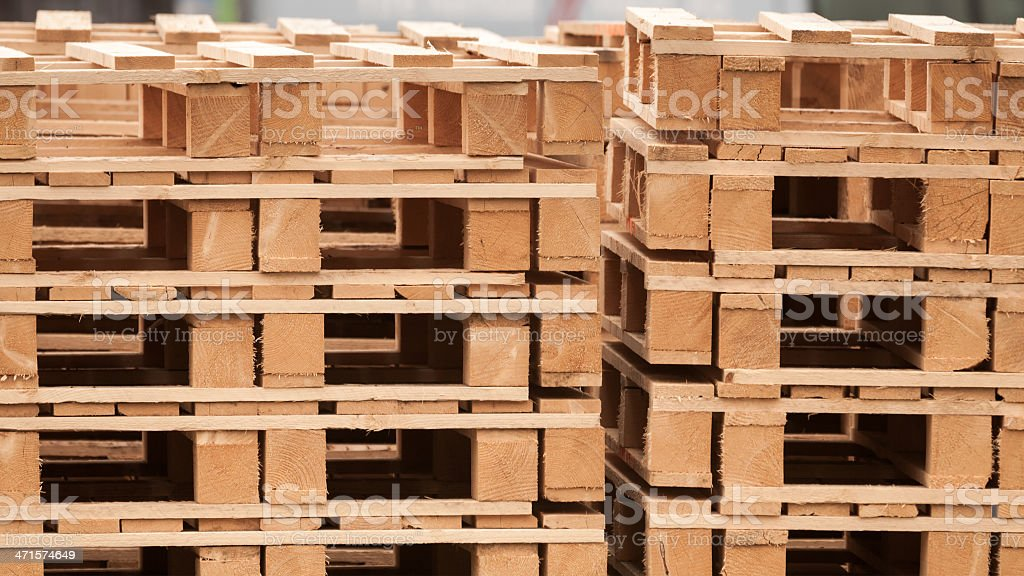 Pile of wooden pallets on a storage area royalty-free stock photo