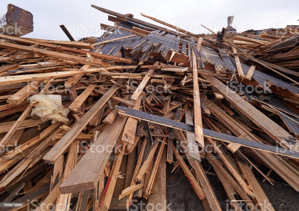 Pile of wooden planks at demolition site ready the recycling stock photo