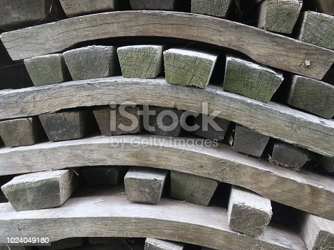 a pile of wooden staves of an old beer keg or barrel