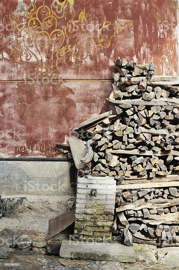 Pile of Woods on the red wall royalty-free stock photo