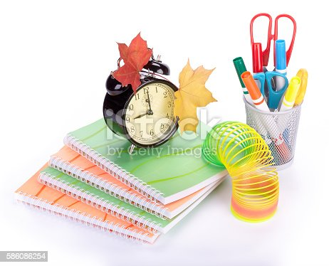 153178960istockphoto Pile of writing-book and alarm clock 586086254
