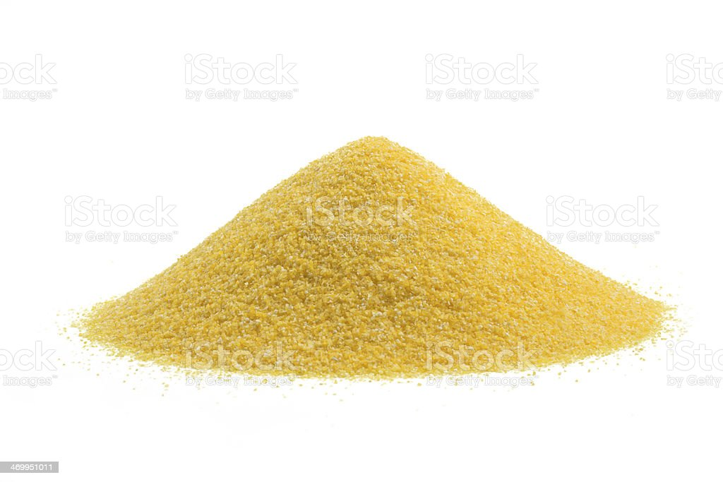 Pile of yellow cornmeal on a white background stock photo