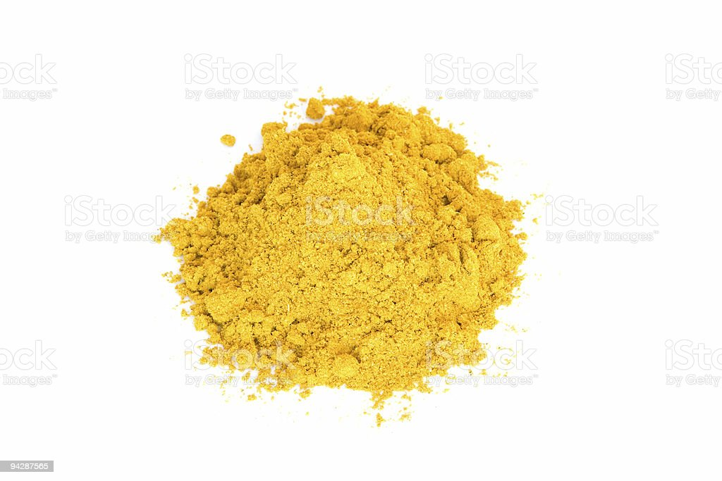 Pile of yellow curry on white royalty-free stock photo