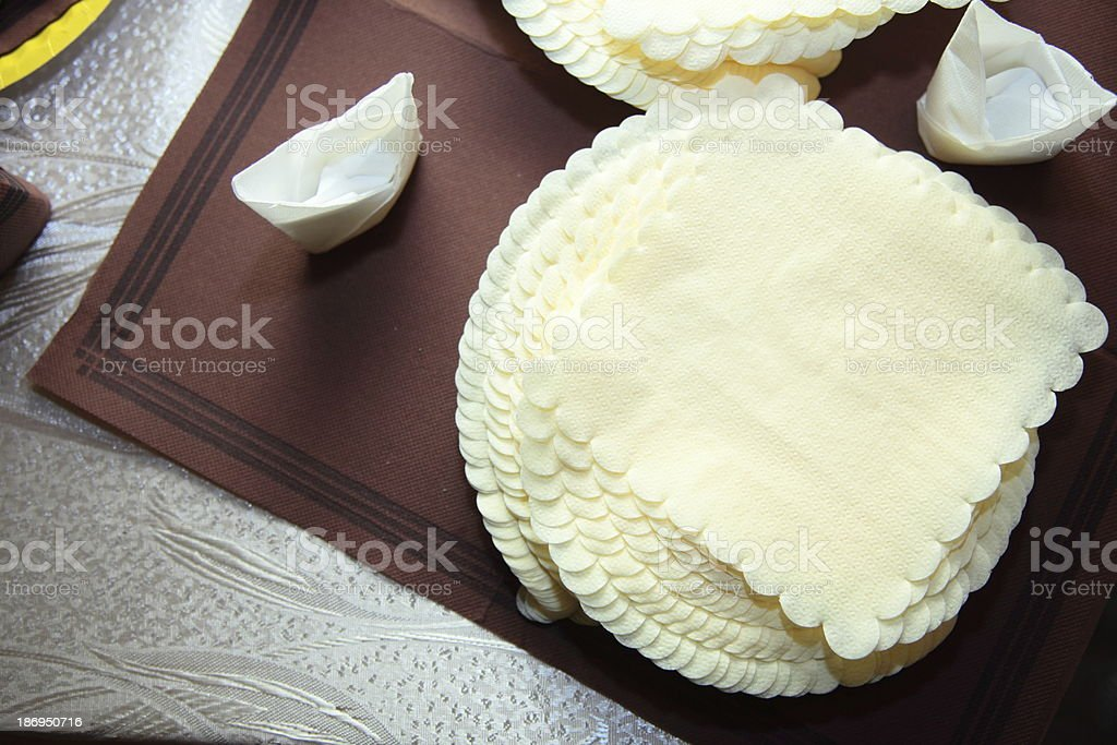 pile of yellow paper napkin on table royalty-free stock photo