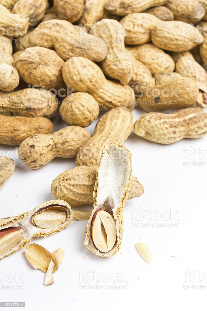 pile shelled big peanuts with some cracked royalty-free stock photo