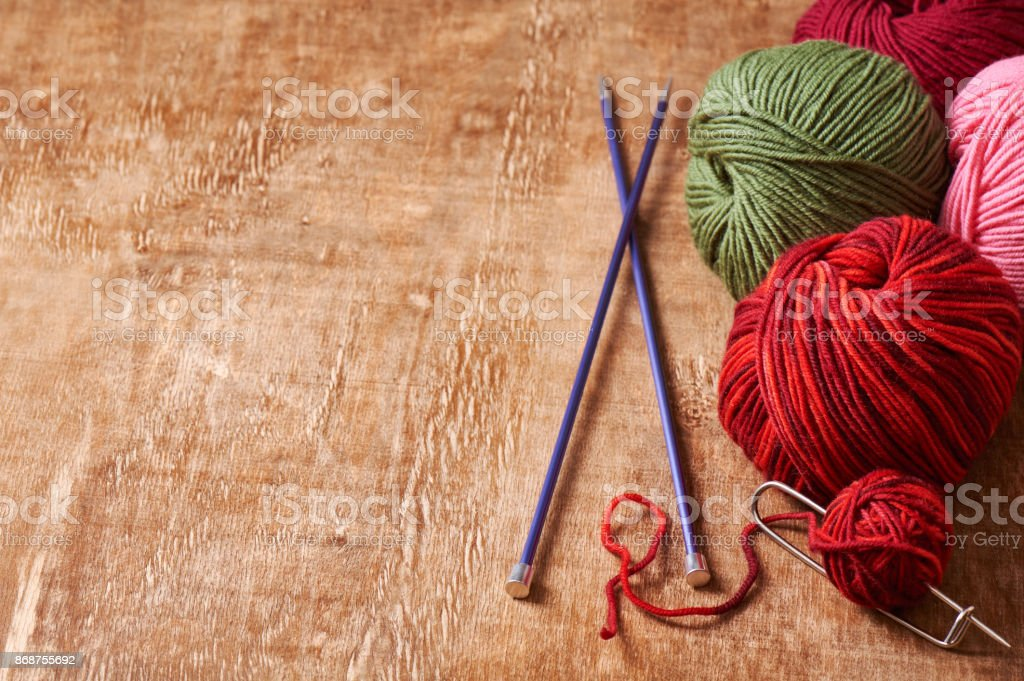 Pile skeins of yarn and knitting needles stock photo