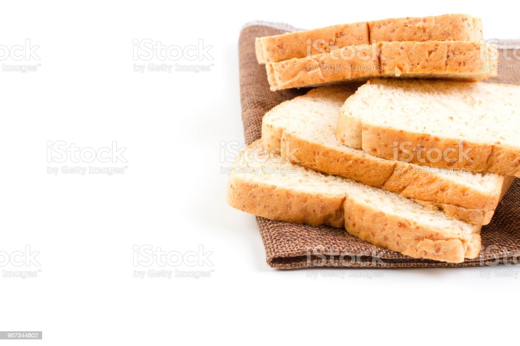 Pile Slice Of Whole Wheat Bread On Dark Brown Calico Stock