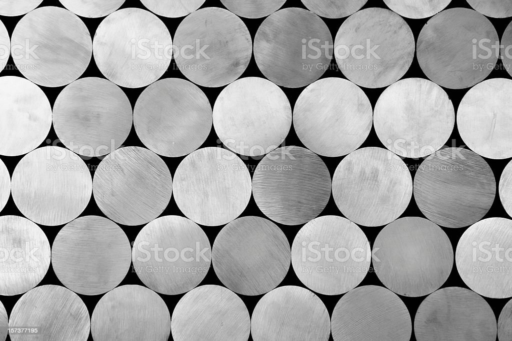 piled aluminium rods stock photo