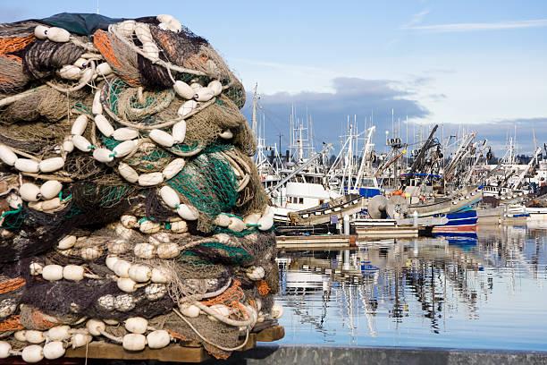 Extrem Fischnetz mit Booten im Hintergrund – Foto