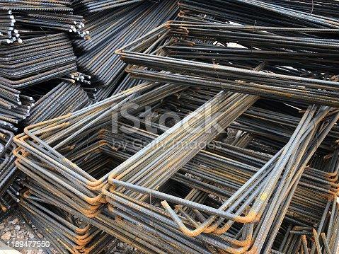 istock Piled iron reinforcement workpieces. Bent metal parts for reinforcement 1189477550