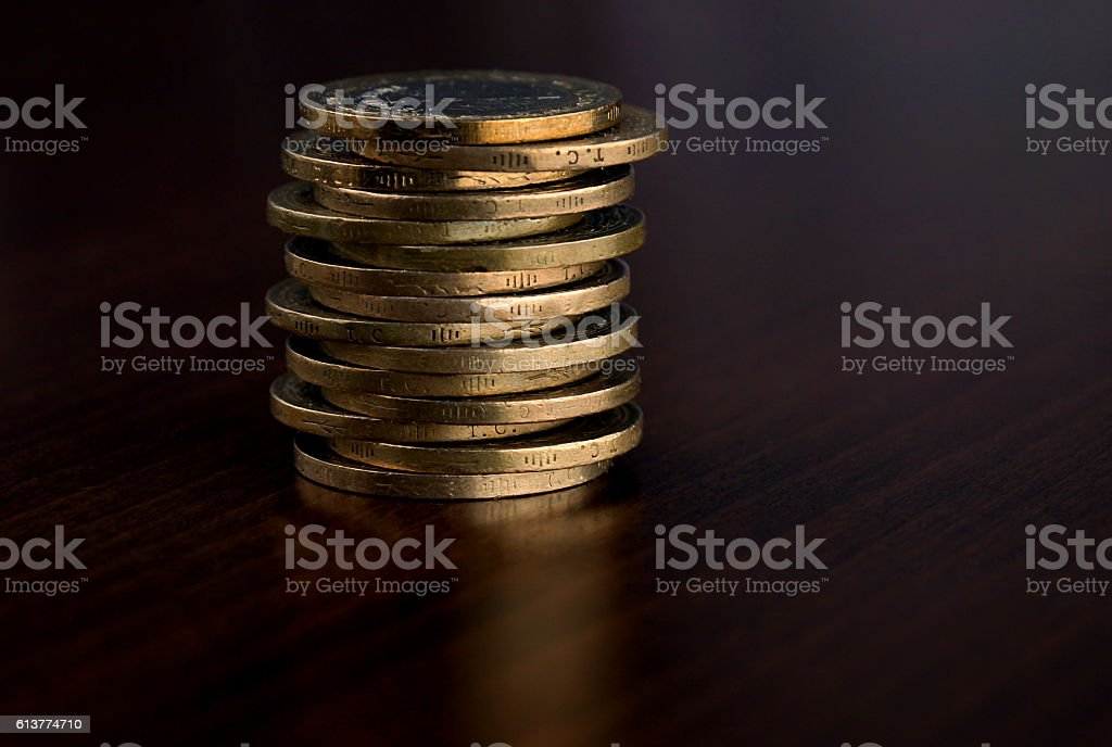Piled on coins. Coins one after the other stock photo