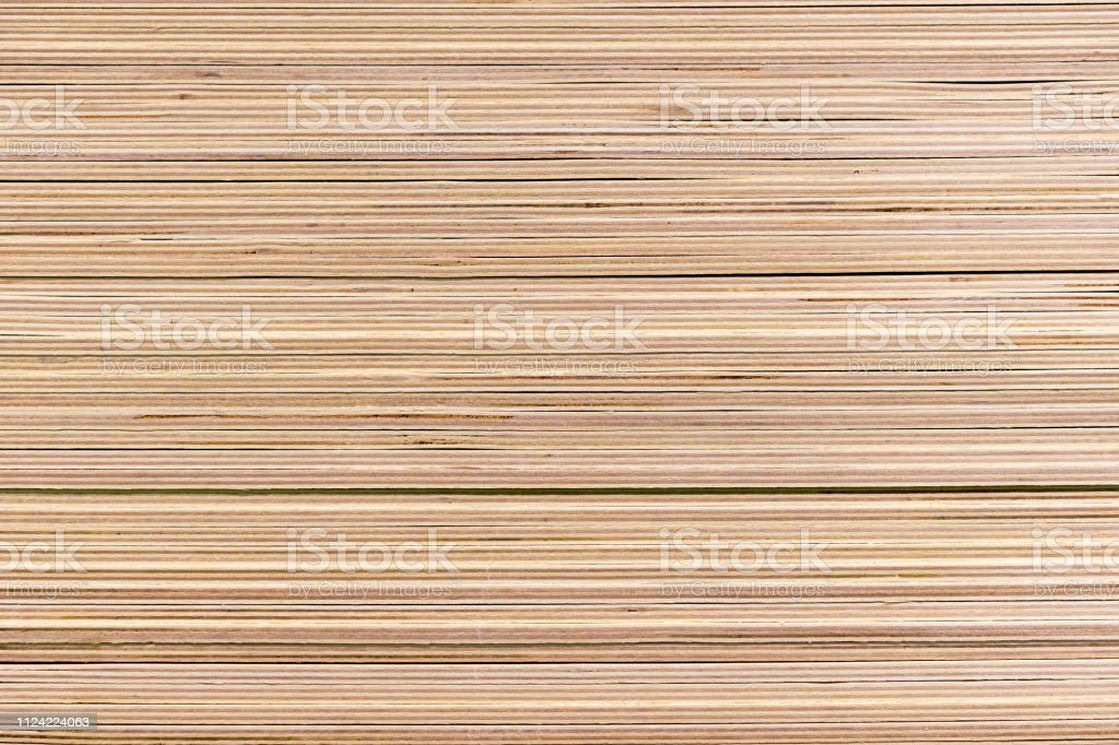 Piled sheets of plywood in a building materials store.