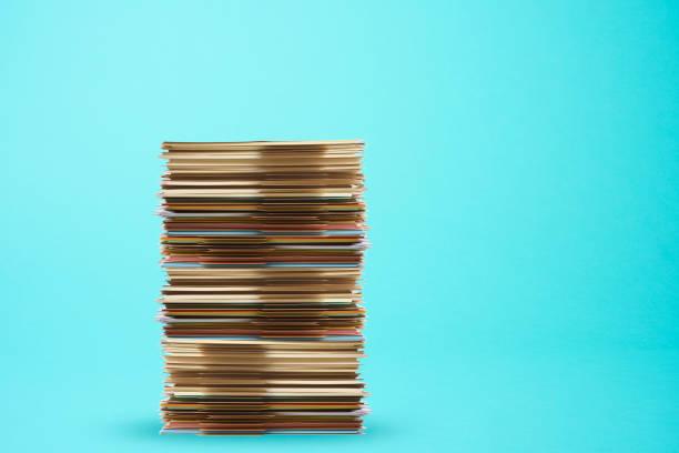 Piled up file folder on light blue background stock photo
