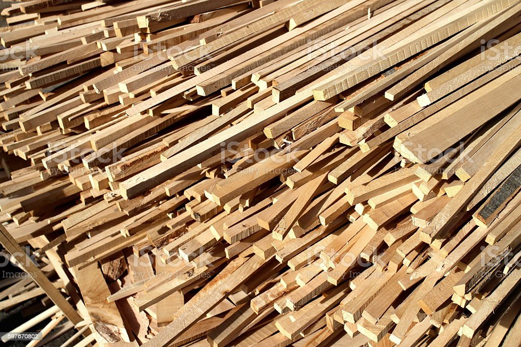 Piled wooden beams stock photo