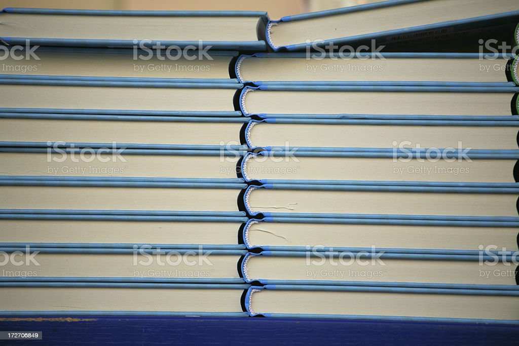 Piles of blue books in a bookstore royalty-free stock photo