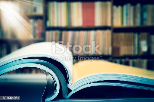 istock Piles of books and magazines on background of book shelf 624004954