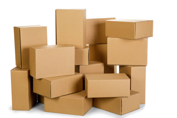 piles of cardboard boxes on a white background stock photo