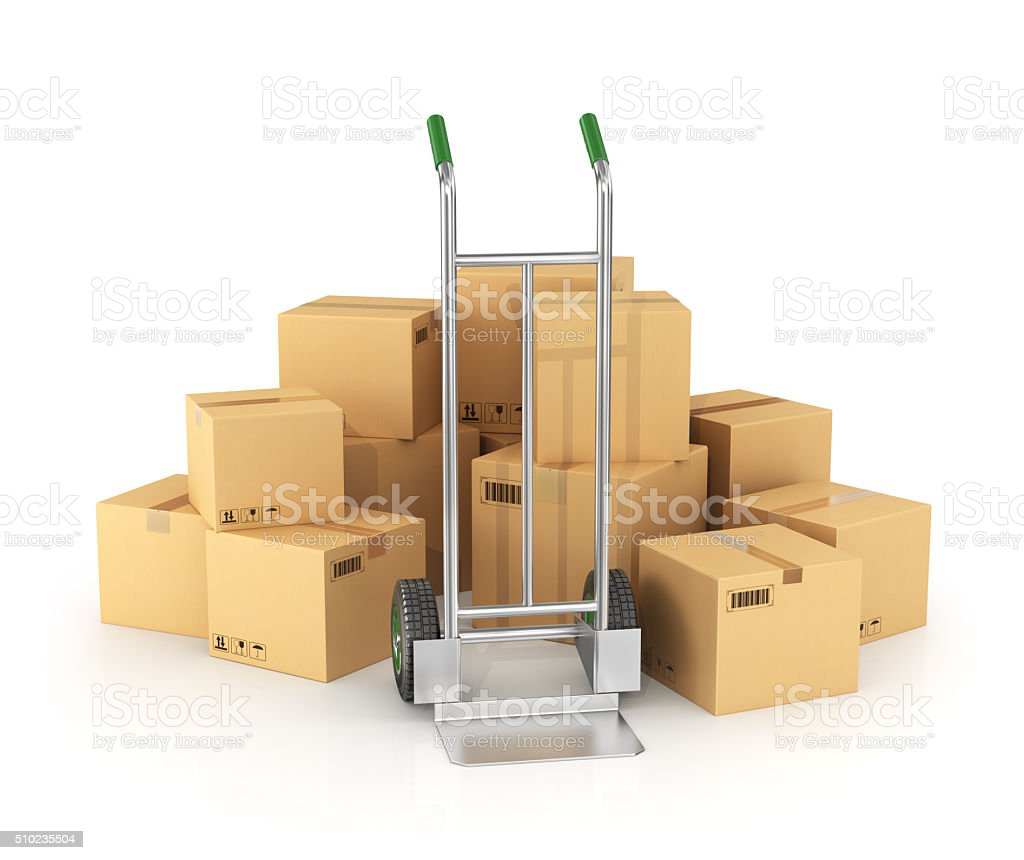 Piles of cardboard boxes with hand truck stock photo